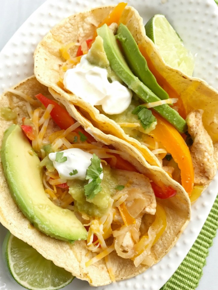 Chicken fajitas are baked in the oven and only one pan of sliced chicken breasts and sweet peppers covered in a flavorful marinade. Serve with some corn and flour tortillas, guacamole, pico de gallo, shredded cheese, and sour cream. These oven baked chicken fajitas are a family favorite!