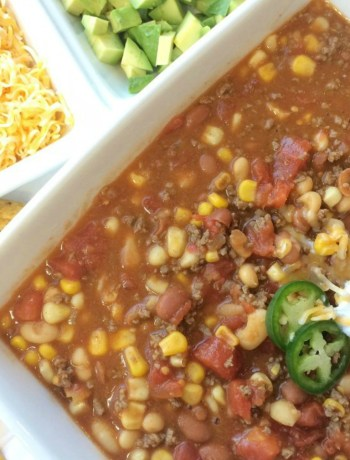 This easy Texas Taco Chili is loaded with flavor and comes together in 30 minutes. This will become a family favorite because it's so fun to load up with your toppings and then dip Fritos in it. Chips for dinner!