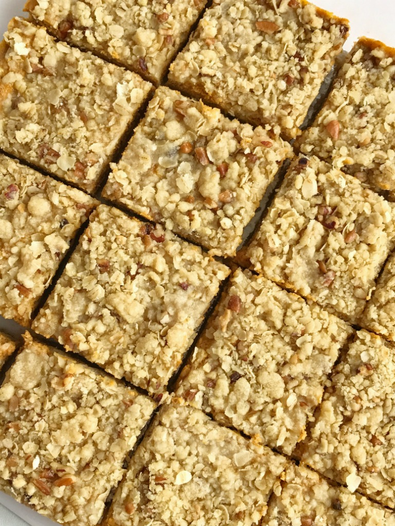 Pumpkin pie crumble bars tastes just like pumpkin pie but in bar form! A brown sugar, oat, pecan crumble with a sweet and creamy pumpkin cheesecake middle. These bars are one of our favorite pumpkin desserts. They are a must-make.