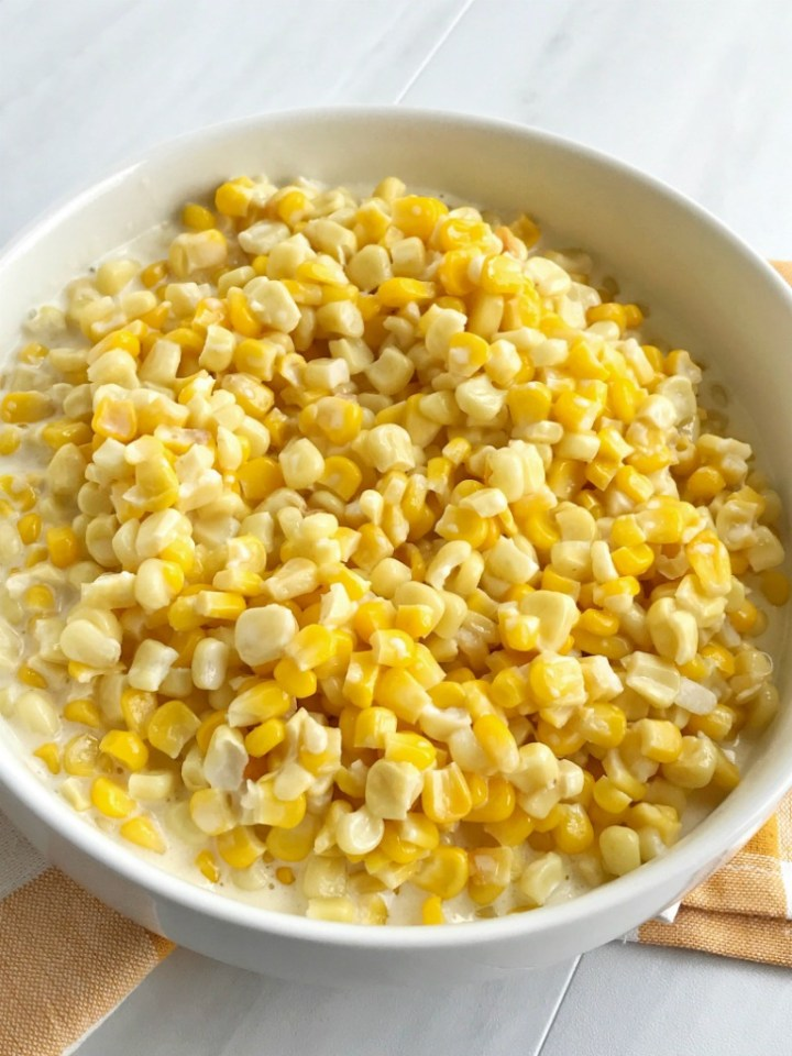 This easy slow cooker creamed corn is only 5 ingredients! So creamy, delicious, and way better than the canned stuff. This would make a great side dish for any dinner.