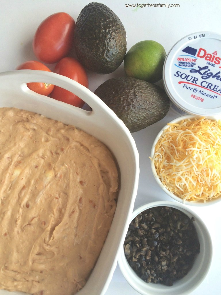 Layers of beans, sour cream, fresh guacamole, shredded cheese, and loaded with fresh veggies! This 7 layer dip will be onethat no onecan refuse. Serve with some crisp corn tortilla chips.