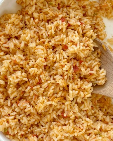 Easy Mexican Rice uses simple ingredients like canned chicken broth, prepared salsa, and there is no chopping needed! Fluffy, flavorful Mexican rice that is so easy to make in one pot.