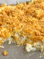 Frozen shredded potatoes make this cheesy shredded potato casserole side dish so easy to prepare! Loaded with cheese, green onions, and sour cream. Topped with a crunchy & cheesy topping that gets crispy while cooking