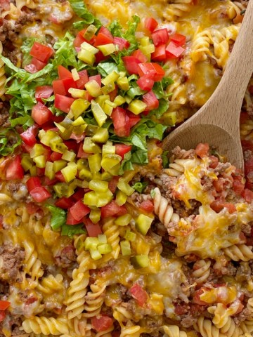 Cheeseburger Casserole is full of cheeseburger favorites like ground beef, onion, garlic, diced tomatoes, spiral pasta, mustard, seasonings, and lots of cheese. Different from traditional creamy, canned soup casseroles and it's family friendly!