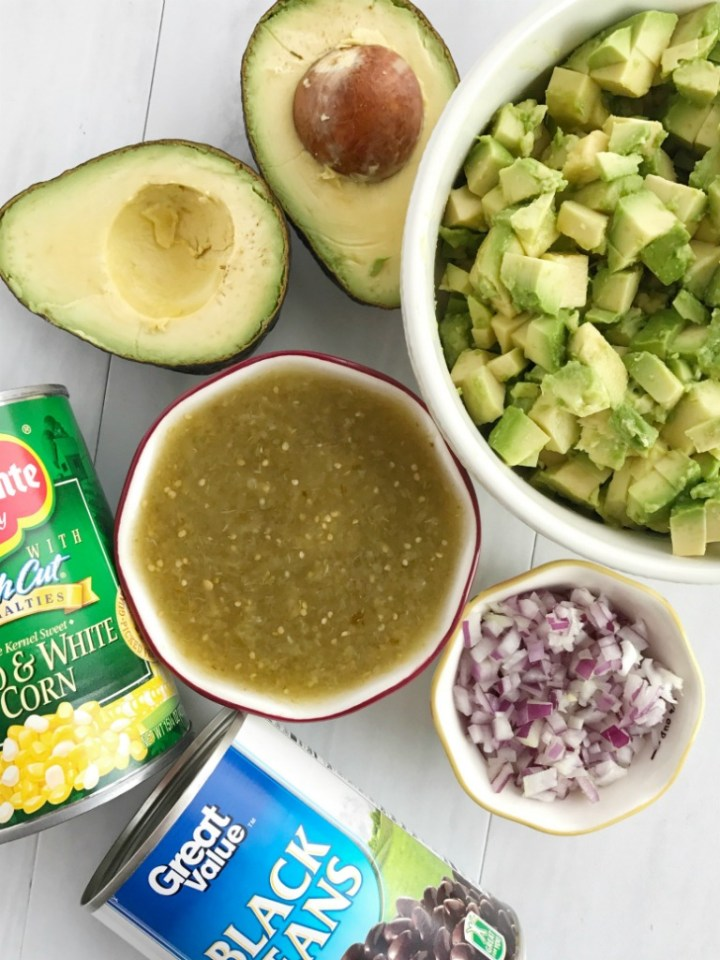 Avocado Dip | Appetizer | Dip | Dips with Avocados | Super Bowl Food | Party Food | Avocado dip is packed full with chunky avocados, corn, black beans, red onion and then drizzled with easy & convenient canned salsa verde. So much flavor with very little effort. Avocado dip is the best game day appetizer, chip dip, and party food | Together as Family #appetizerrecipes #appetizer #gamedaydips #gamedayappetizers #avocadodip #avocadodiprecipe #avocados