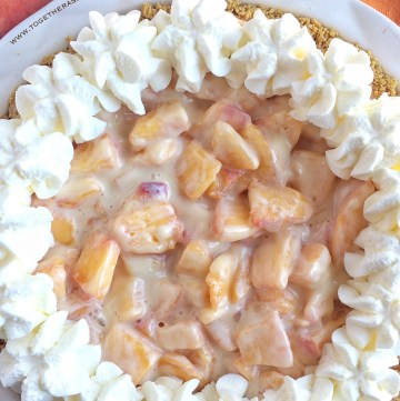 Graham cracker crust filled with fresh peaches, sweetened condensed milk and fresh whipped cream!