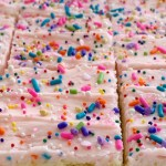 Sugar Cookie Bars | Sugar Cookie Bars are thick, soft-baked and topped with the best cream cheese frosting! Sugar cookie bars bake in a cookie sheet so there is plenty serve a crowd. Change up the frosting color and sprinkles for any event or Holiday.