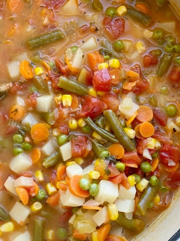 Vegetable Soup is packed with healthy and nutritious ingredients. Fresh vegetables in a perfectly seasoned broth base, and it cooks in one pot on the stove! Keeps for a week so leftovers are perfect for a healthy lunch.