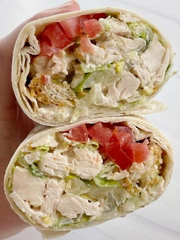 Chicken caesar salad wraps recipe with rotisserie chicken and homemade Caesar salad dressing.