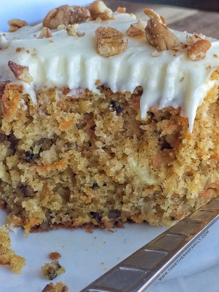 This pineapple pecan carrot cake is unbelievably moist and loaded with classic carrot cake flavors; crushed pineapple, pecans, cinnamon, nutmeg, and loaded with carrots. Topped with a tangy & sweet cream cheese frosting.