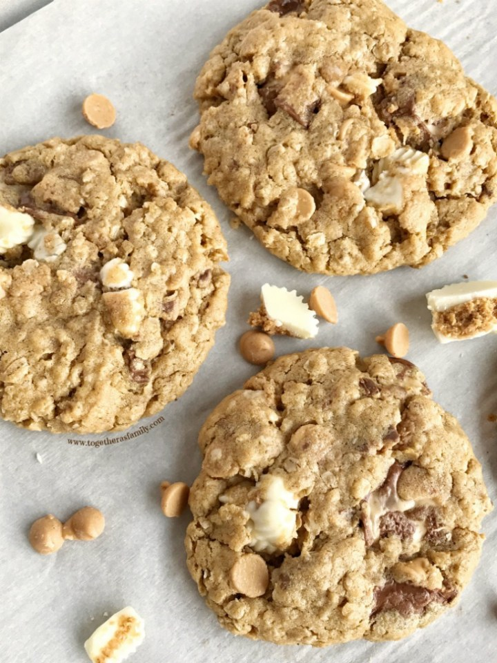 Soft-baked, thick, and chewy loaded reese's oatmeal peanut butter cookies loaded with peanut butter chips and 3 different kinds of Reese's chocolate candy bars! If you love Reese's and peanut butter then these will be your new favorite!