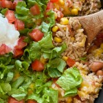 Turkey Taco Rice Skillet is a one pan dinner that's loaded with ground turkey, beans, corn, tomatoes, rice, cheese, and seasonings. Simmers in beef broth for an easy skillet dinner recipe with ground turkey.
