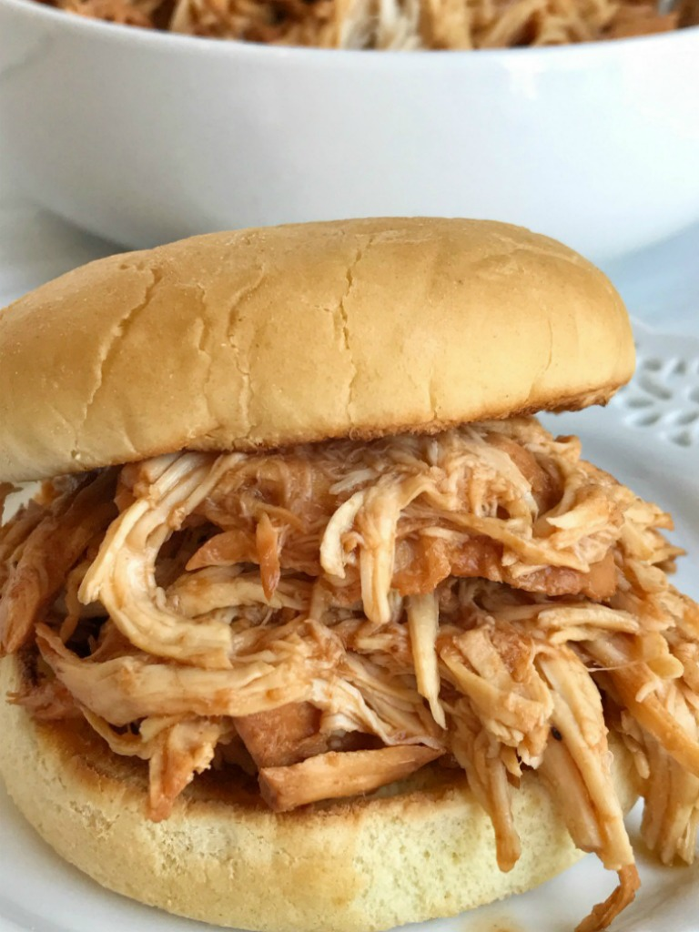 Root beer BBQ chicken sandwiches are so incredibly easy to make! 3 ingredients and a slow cooker are all you need for a delicious dinner that is ready when you are. Perfect for a busy weeknight, picnic, potluck, or BBQ. Root beer, chicken breasts, BBQ sauce, and a few spices are all you need.