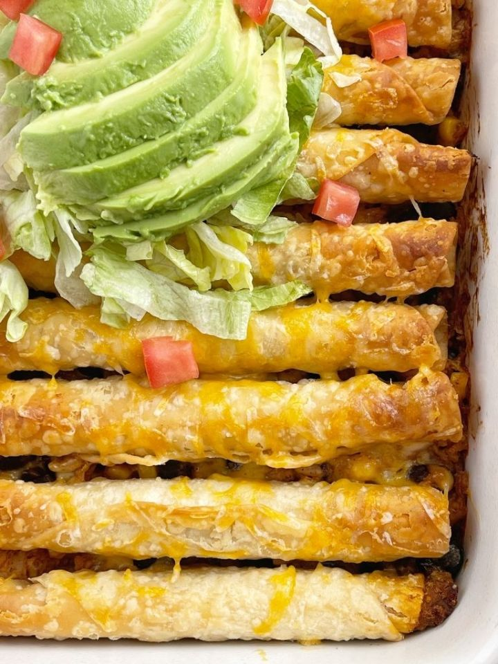 Beef taquito casserole is so easy to make with frozen taquitos and topped with all your favorite taco toppings.