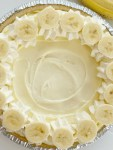 Banana Cream Pie has three layers of banana pudding, cheesecake, and cheesecake whipped topping inside a shortbread crust. This no bake pie takes just minutes to prepare and it's the best banana cream pie because it has no browned, mushy bananas in it!