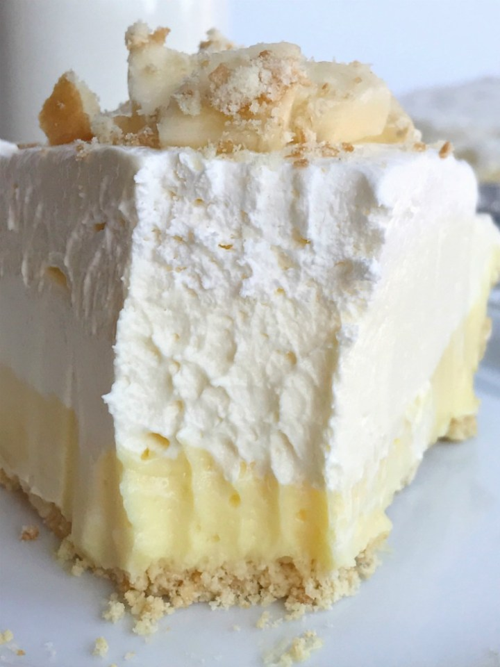 Triple layer banana pudding cheesecake pie is a no bake dessert that is so creamy delicious and tastes just like banana pudding! If you're not a fan of brown bananas in traditional banana pudding then you will love this! Perfect for an easy dessert or the Thanksgiving dessert table.