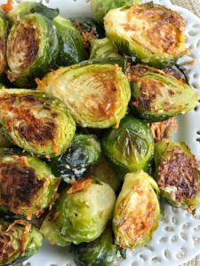 Oven roasted parmesan Brussel sprouts are a quick & easy 20 minute side dish that is healthy and delicious. Only a few simple ingredients to the best Brussel sprouts that are bursting with flavor!
