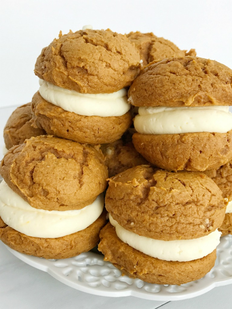 You only need 5 ingredients for the best pumpkin dessert of Fall; pumpkin cheesecake whoopie pies. Fluffy & sweet cheesecake whipped cream in between two soft pumpkin cookies. Not only are these so easy but they will disappear just as fast.