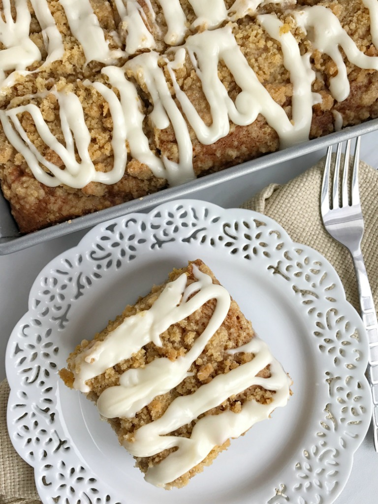 Moist and tender pumpkin cake loaded with warm pumpkin spices and topped with a sweet cinnamon & brown sugar streusel. Mix up a simple vanilla glaze to drizzle over the top. This streusel pumpkin cake is the best Fall pumpkin dessert recipe | www.togetherasfamily.com #pumpkinrecipes #pumpkin_recipes #pumpkincake