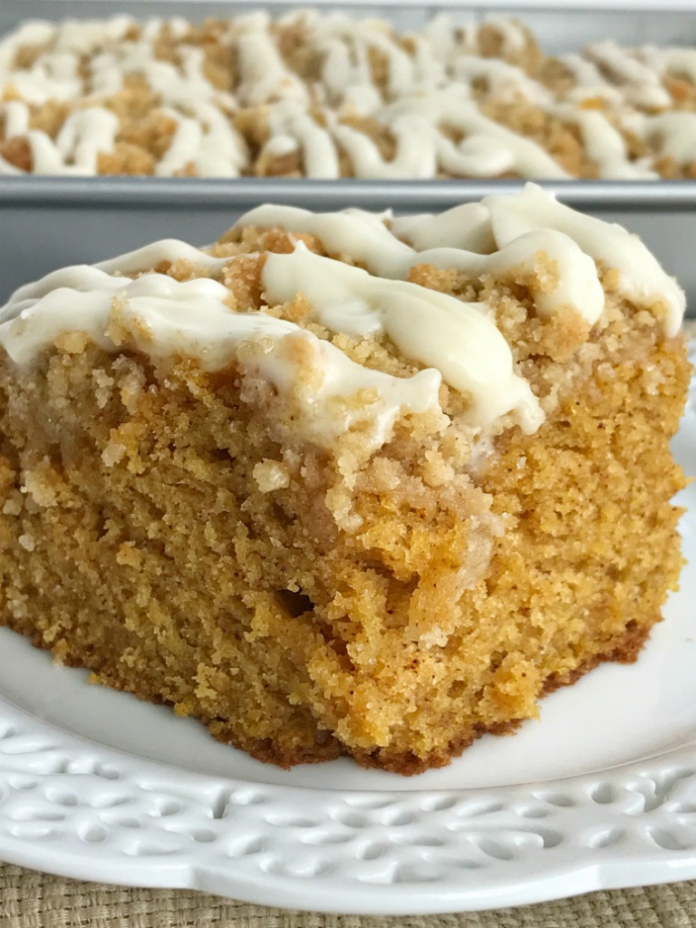 Moist and tender pumpkin cake loaded with warm pumpkin spices and topped with a sweet cinnamon & brown sugar streusel. Mix up a simple vanilla glaze to drizzle over the top. This streusel pumpkin cake is the best Fall pumpkin dessert recipe   www.togetherasfamily.com #pumpkinrecipes #pumpkin_recipes #pumpkincake