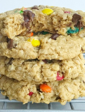 No flour monster cookies are soft-baked and so chewy! Loaded with oats, peanut butter, mini m&m's, and chocolate chips. Perfect cookies for those with a gluten allergy; just make sure your oats are gluten-free. This cookie recipe freezes perfectly so they're also a great lunch box treat all week   www.togetherasfamily.com #monstercookies #recipe #cookierecipes #glutenfreedesserts #glutenfree #noflourcookies #noflour