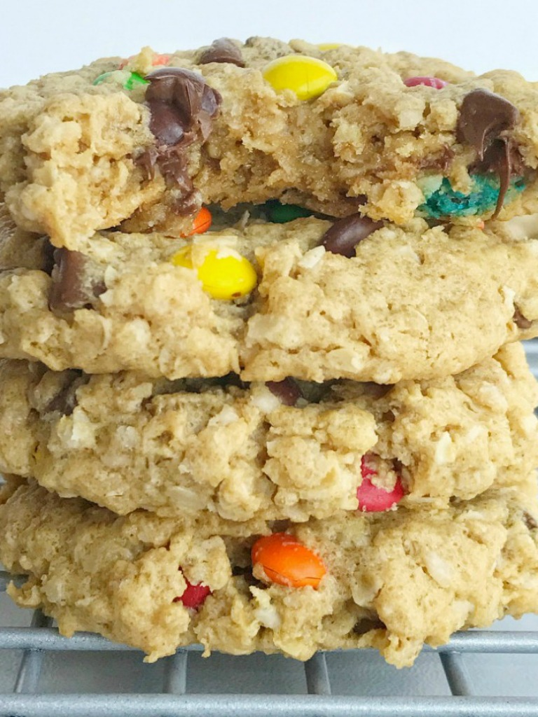 No flour monster cookies are soft-baked and so chewy! Loaded with oats, peanut butter, mini m&m's, and chocolate chips. Perfect cookies for those with a gluten allergy; just make sure your oats are gluten-free. This cookie recipe freezes perfectly so they're also a great lunch box treat all week | www.togetherasfamily.com #monstercookies #recipe #cookierecipes #glutenfreedesserts #glutenfree #noflourcookies #noflour