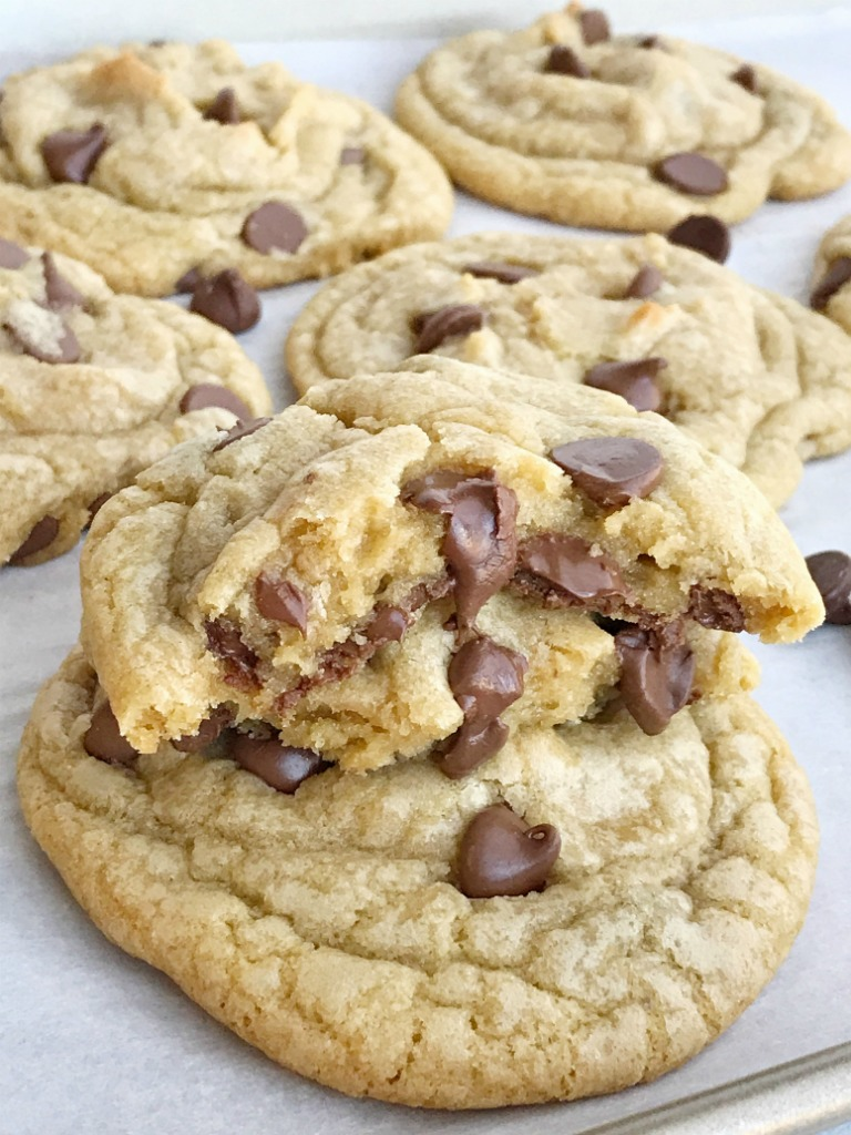 Hands down, these are the best and most perfect chocolate chip cookies! Big, soft-baked centers with buttery and chewy edges. Studded with milk chocolate chips. The secret is in how you shape the dough balls before baking. You MUST TRY this recipe for perfect chocolate chip cookies | www.togetherasfamily.com #cookies #chocolatechipcookies #chocolatechipcookierecipes #chocolate