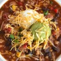 Southwestern Turkey Chili Taco Soup   Turkey chili taco soup loaded with all the best southwest flavors. Turkey taco meat, chili beans & spices, corn, tomato, and taco soup seasonings all combine for one deliciously hearty chili taco soup. It's the best of both worlds. Top with cheese, sour cream, guacamole, and crushed tortilla chips   www.togetherasfamily.com #tacosoup #chilirecipe #turkeychili #dinnerrecipes