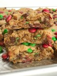 No Flour Monster Cookie Bars | Celebrate the holidays and make Santa's favorite Christmas cookie bars! No flour Christmas cookie bars are loaded with oats, peanut butter, chocolate, and festive green & red mini m&m's. Thick, chewy bars that everyone loves and they only take minutes to make | www.togetherasfamily.com #christmascookies #noflourdesserts #monstercookiebars #noflourbars #cookiebarrecipes
