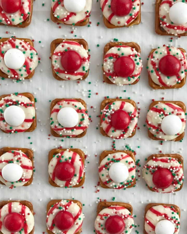 Peppermint Bark Pretzel Bites | white chocolate m&m candy. Perfect for Christmas cookie plates or just a fun Holiday treat | www.togetherasfamily.com #christmascookies #peppermintrecipes #peppermintdesserts #christmasdesserts #candycanerecipes