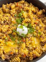 BBQ beef skillet dinner recipe with ground beef, pasta, corn, and beef broth.