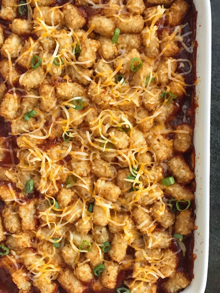 BBQ Beef Sloppy Joe Tater Tot Casserole   Sloppy joe tater tot casserole is a family favorite dinner. Seasoned bbq ground beef is topped with cheese and mini tater tots that are cooked to crispy perfection. Kids love this sweet bbq tater tot casserole   Together as Family #casserolerecipes #easydinnerrecipes #groundbeefrecipes