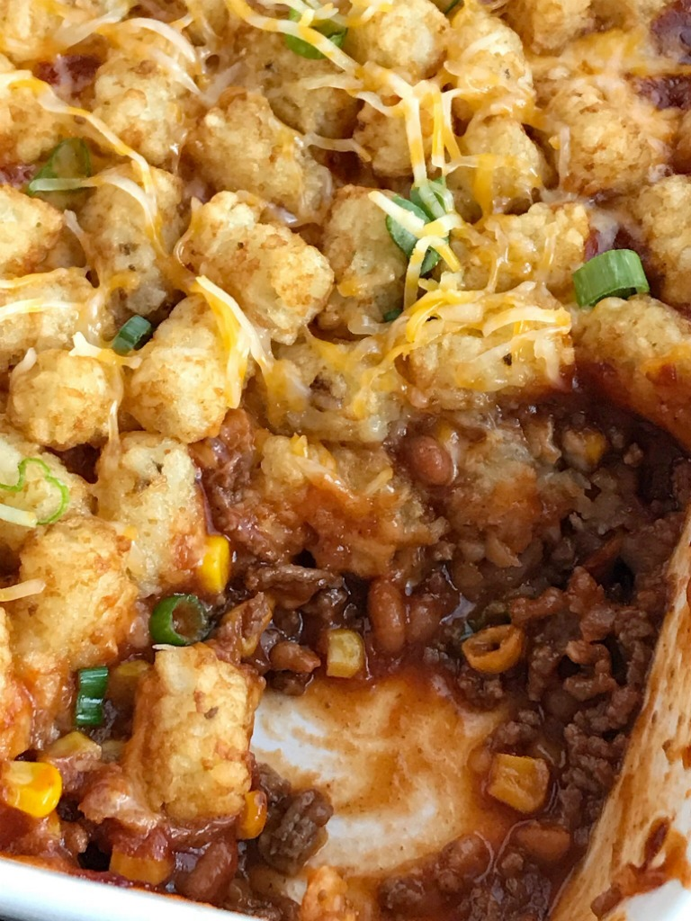 BBQ Beef Sloppy Joe Tater Tot Casserole | Sloppy joe tater tot casserole is a family favorite dinner. Seasoned bbq ground beef is topped with cheese and mini tater tots that are cooked to crispy perfection. Kids love this sweet bbq tater tot casserole | Together as Family #casserolerecipes #easydinnerrecipes #groundbeefrecipes