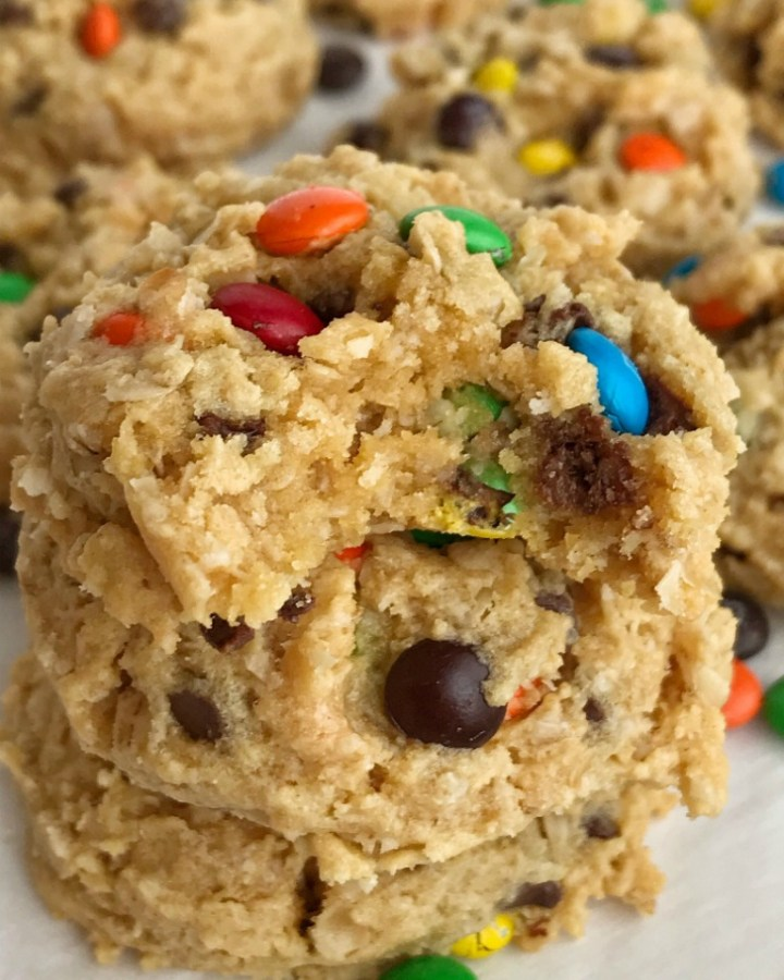 Cake Mix Monster Cookies | Cake mix monster cookies are an easy and fun twist to the classic monster cookie. A yellow cake mix, peanut butter, oats, chocolate chips, and m&m's create a thick, soft-baked, and chewy cake mix monster cookies that are so easy to make #cookierecipes #monstercookierecipes #cookies #peanutbuttercookies