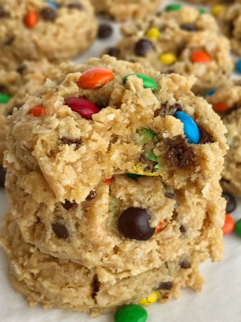 Cake Mix Monster Cookies   Cake mix monster cookies are an easy and fun twist to the classic monster cookie. A yellow cake mix, peanut butter, oats, chocolate chips, and m&m's create a thick, soft-baked, and chewy cake mix monster cookies that are so easy to make #cookierecipes #monstercookierecipes #cookies #peanutbuttercookies