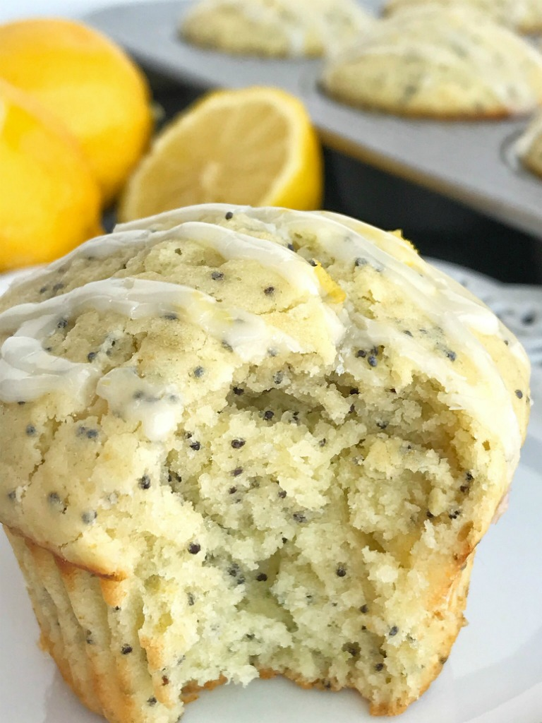 Coconut Lemon Poppyseed Muffins   Perfect coconut lemon poppyseed muffins are a must make for Easter and springtime. Coconut and lemon combine in a soft & moist poppyseed muffin with a lemon glaze on top. These muffins are filled with coconut oil, coconut extract, fresh lemon zest & juice, and poppyseeds #muffins #muffinrecipes