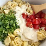 Creamy Tortellini Artichoke Pasta Salad | Creamy tortellini artichoke pasta salad requires only 5 ingredients! It's so quick & easy and perfect for a BBQ, picnic, light lunch, or a side dish. Marinated artichoke hearts, cherry tomatoes, green onions, tortellini, and creamy Italian dressing create a delicious pasta salad #pastasaladrecipes #artichokerecipes #tortellini