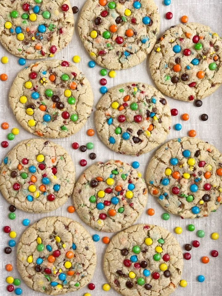 An overhead shot of m&m cookies on a cookie sheet.