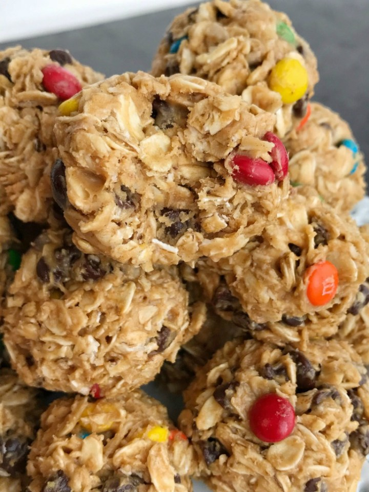 Monster Cookie Energy Balls | Energy Bites | Oatmeal Energy Balls | Healthy Snacks | Monster cookie energy balls are a great afternoon energy boost or perfect for an after school snack. Hearty oats, chocolate chips, peanut butter, honey, and m&m's make these energy balls so delicious and fun. They only take minutes to make and kids can even do it themselves!