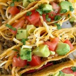(15 minute) Salsa Verde Beef Tacos | Salsa verde beef tacos can be on the dinner table in just 15 minutes! Ground beef seasoned with homemade taco seasoning and jarred salsa verde. So much flavor that pairs well with all the toppings in crunchy corn taco shells #taco #tacos #tacorecipes #easydinnerrecipes #dinner #mexicanfood