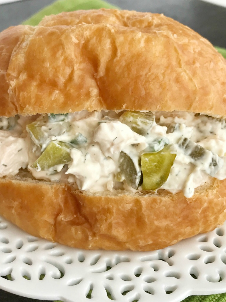 Dill Pickle Chicken Salad Sandwiches | Chicken Salad | Dill pickle chicken salad is a fun twist to original chicken salad. Chunks of chicken, dill pickles, and green onions get smothered in an ultra creamy sauce that has dill pickle juice in it! Serve on rolls, croissants, or inside lettuce for a low carb option. Chicken salad sandwiches are great for picnics, parties, potlucks, or even lunch and dinner.