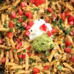 One Pan Beef Taco Pasta Skillet | Skillet Dinner | One Pan | Beef Taco Recipe | Pasta Recipe | One pan & 30 minutes is all it takes for cheesy beef taco pasta skillet dinner recipe. Tender pasta and taco seasoned ground beef simmer in salsa and beef broth and then gets covered in cheese. Serve with all your favorite taco toppings for an easy and simple dinner. #easydinnerrecipes #skilletmeals #onepan
