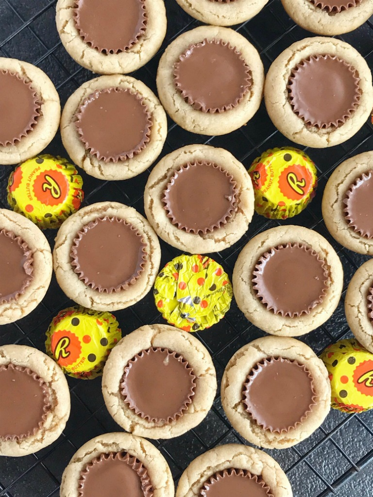 Reese's Peanut Butter Cookie Cups   Peanut Butter Cookies   Reese's   Peanut butter cookie cups filled with a Reese's chocolate peanut butter candy. #dessert #dessertrecipes #easydessertrecipe #recipe #peanutbutter #reeses