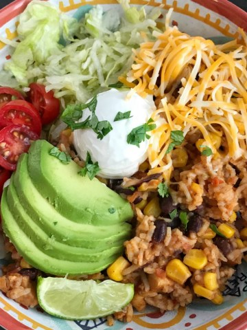 Instant Pot Chicken Burrito Bowls   Instant Pot Recipe   Chicken Recipes   Instant Pot Chicken Recipes   Burrito Bowls   Instant Pot chicken burrito bowls can be on the dinner table in 30 minutes! All your favorite things about a burrito but made into a delicious burrito bowl. Top with lettuce, cheese, tomato, avocado for a quick & easy family approved dinner. If you're looking for the best Instant Pot chicken recipe then this is it! #instantpotrecipe #instantpot #chicken #dinner #easydinner