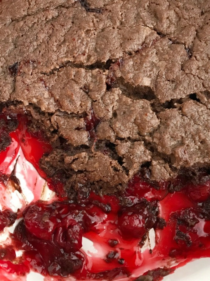 Black Forest Chocolate Cobbler   Chocolate Cobbler   Black Forest Dessert   Desser Recipes   Chocolate cobbler gets a fun black forest twist with canned cherry pie filling. You only need 4 ingredients to make this easy black forest chocolate cobbler dessert. Serve with some whipped cream or a scoop of ice cream for an easy & simple dessert recipe that everyone will love. #dessert #chocolate #easydessertrecipes