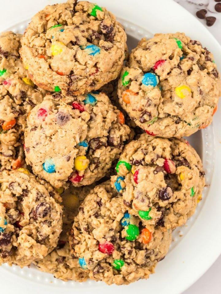 A white plate full of monster cookies.