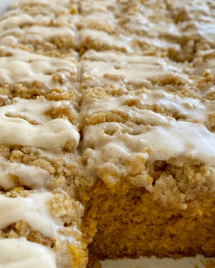 Moist and tender pumpkin cake loaded with warm pumpkin spices and topped with a sweet cinnamon & brown sugar streusel. Mix up a simple vanilla glaze to drizzle over the top. This streusel pumpkin cake is the best Fall pumpkin dessert recipe!