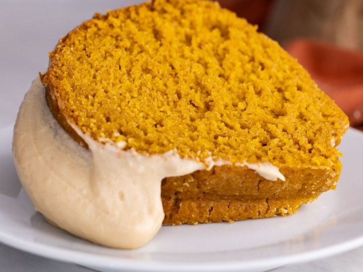 Slice of pumpkin bundt cake laying on its side.