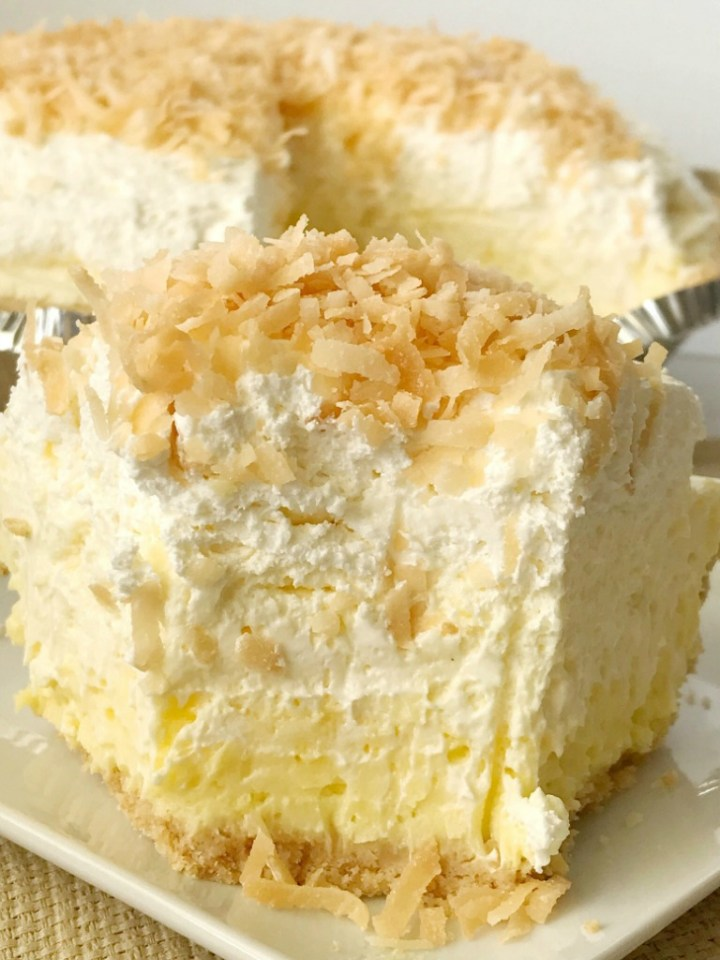 Coconut Cheesecake Cream Pie | Coconut Cream Pie | No Bake Pie Recipe | Coconut cream pie with a cheesecake twist. Easy and simple thanks to the coconut pudding mix and Nilla wafer crust. It's a no bake pie so it's perfect to make the day ahead to save time! Coconut cheesecake cream pie is a must make for Thanksgiving dessert. #thanksgivingrecipe #nobake #pie #coconut #coconutcreampie #recipeoftheday #dessert #dessertrecipe
