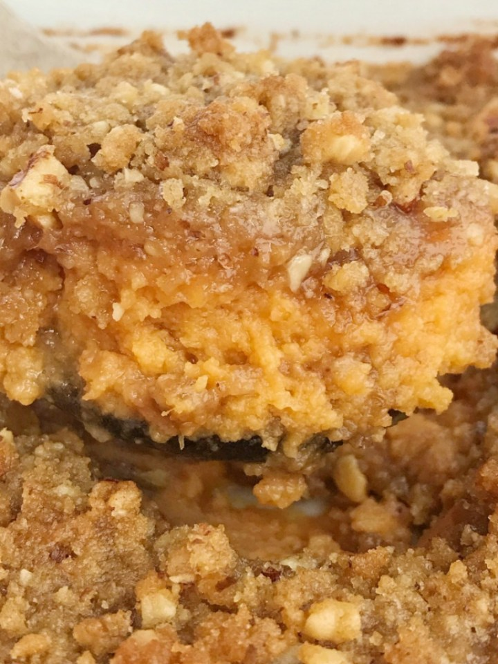 Praline Sweet Potato Casserole | Sweet Potato Casserole | Thanksgiving Recipe | Sweet potato casserole with canned sweet potatoes and a sweet praline crumble topping. This takes just minutes to make thanks to the canned sweet potatoes and no one will ever have to know the delicious shortcut. No heating, boiling, chopping, and mashing sweet potatoes. #thanksgivingrecipes #sweetpotatocasserole #casserole #sidedish #holidayrecipes #recipeoftheday